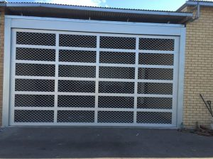 Custom Aluminum Garage Door Commercial Continental Diamond mesh Inserts Gryphon