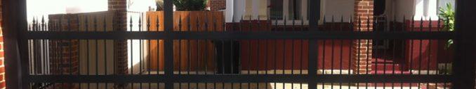 Carport - Custom Aluminum Garage Door - Vertical Bar - spear heads - Gryphon